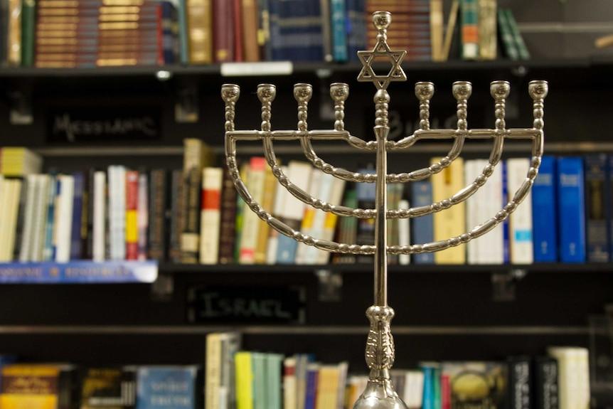 Menorah in front of bookshelf at Jews for Jesus store in Bondi Junction.
