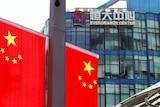 Chinese flags near the logo Evergrande Centrein Shanghai, China, on September 24, 2021.