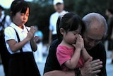 A family prays for Hiroshima bombing victims in Peace Memorial Park.