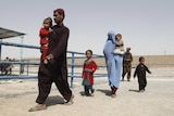 Afghan refugees arrive to be repatriated to Afghanistan, at the UNHCR office on the outskirts of Quetta, Pakistan.