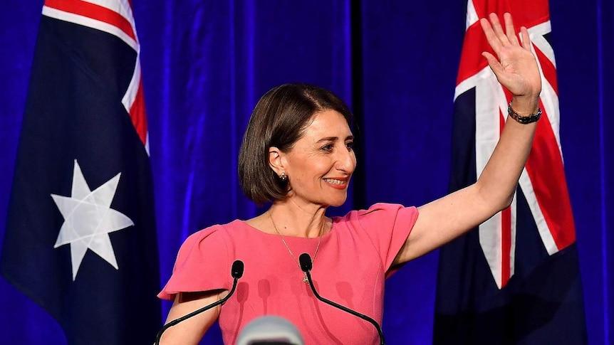 Politics waving in front of Australian flags.