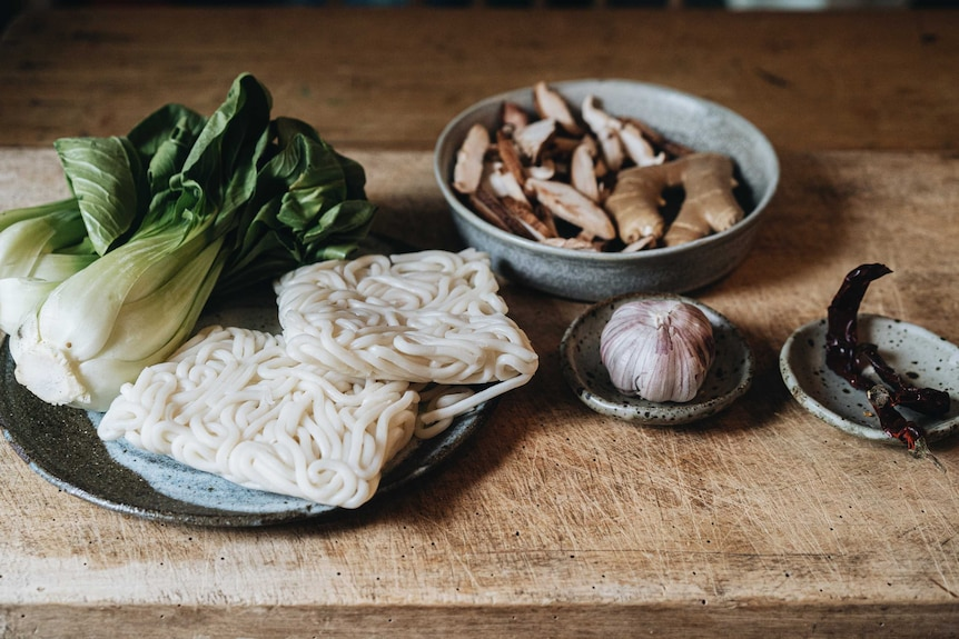Bok choy, udon noodles, mushrooms, garlic, chilli and ginger are pantry ingredients of this vegetarian soup.