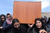 Independent Afghan civil society activist women carry the coffin of Farkhunda, who was lynched by an angry mob in central Kabul