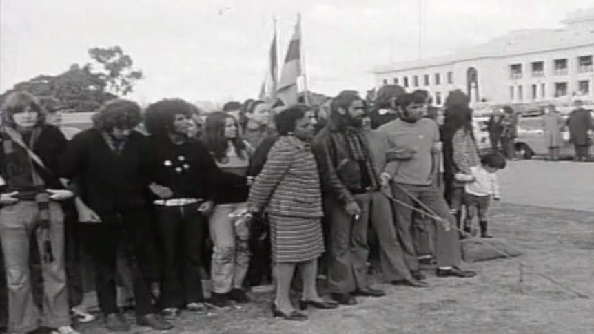 A black and white photo of protestors outside Old Parliament House.