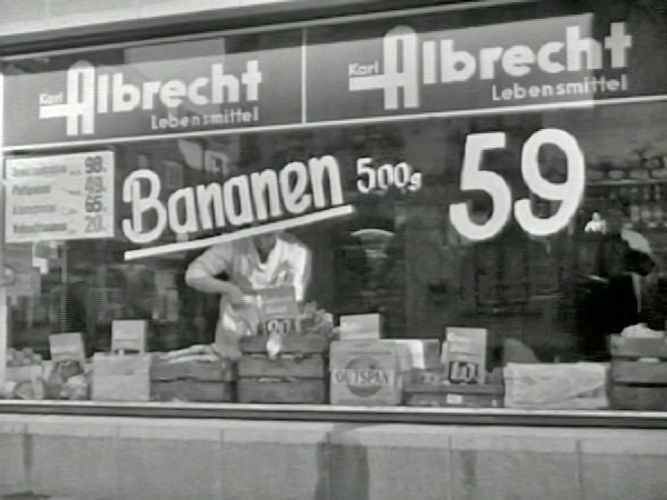 An old black and white photograph of a grocery store