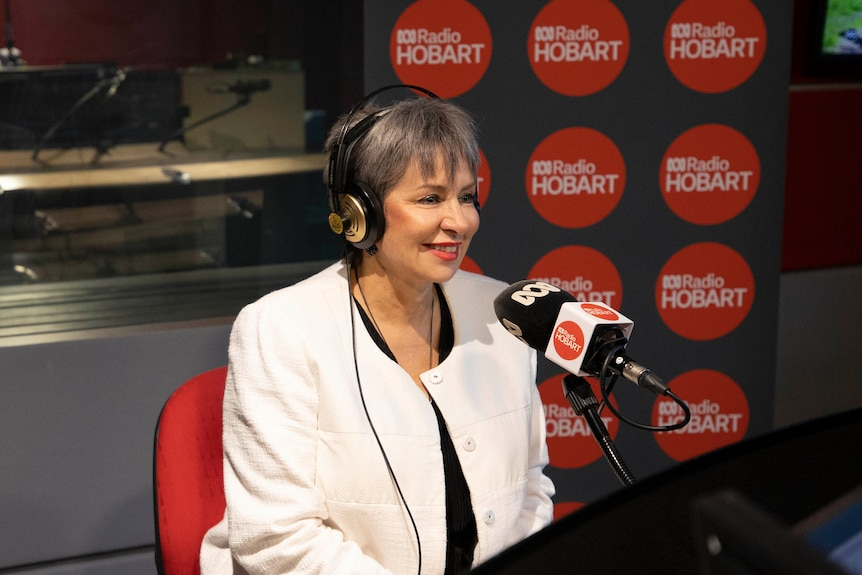 Sue Hickey smiles as she site in the studio's guest chair at ABC Radio Hobart.