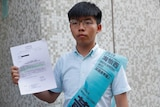 Joshua Wong, secretary-general of Hong Kong's pro-democracy Demosisto party, poses with the letter.
