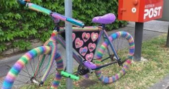 A crocheted rainbow bike.