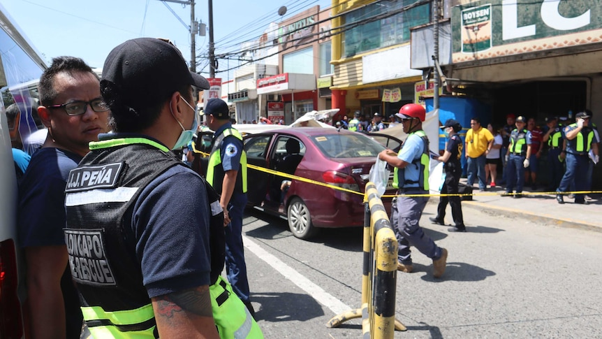 Police examine car after murders in Olongapo