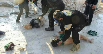 Workers hose down children in suspected Syria gas attack