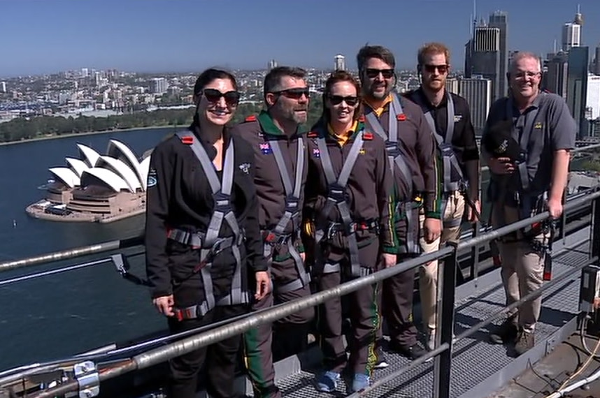 A group of people stand on top of a bridge
