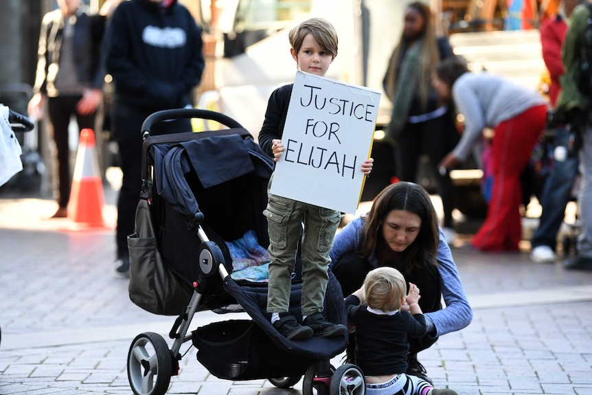Child holds placard at Elijah Doughty protest