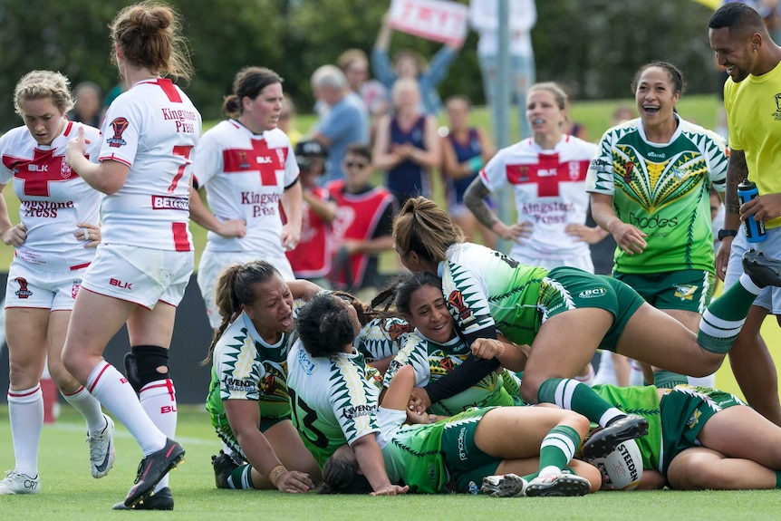 Cook Islands players celebrate win over England