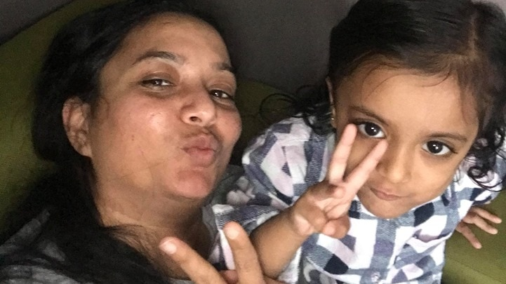 Greeshma Patel and her three-year-old daughter, Prisha, smiling and making peace signs