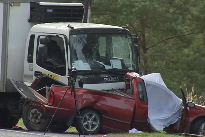 The wreckage of a collision between a truck and a ute.