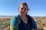 A woman in a bush environment.