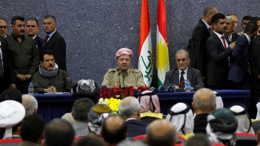 Iraqi Kurdish President Masoud Barzani sits with Kirkuk Governor Najmaldin Karim.