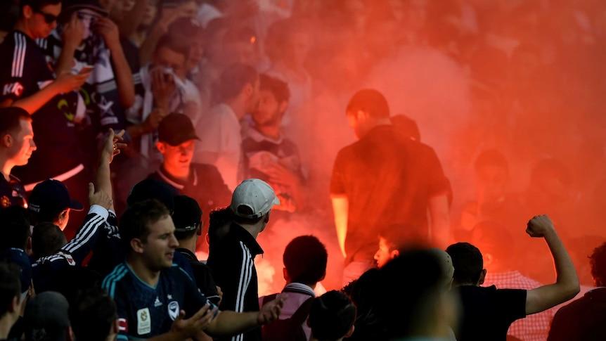 Melbourne Victory fans let off flares against Melbourne City at AAMI Park