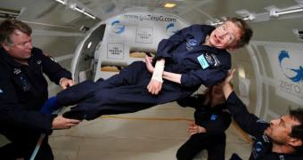 Stephen Hawking floats in a zero-gravity chamber.