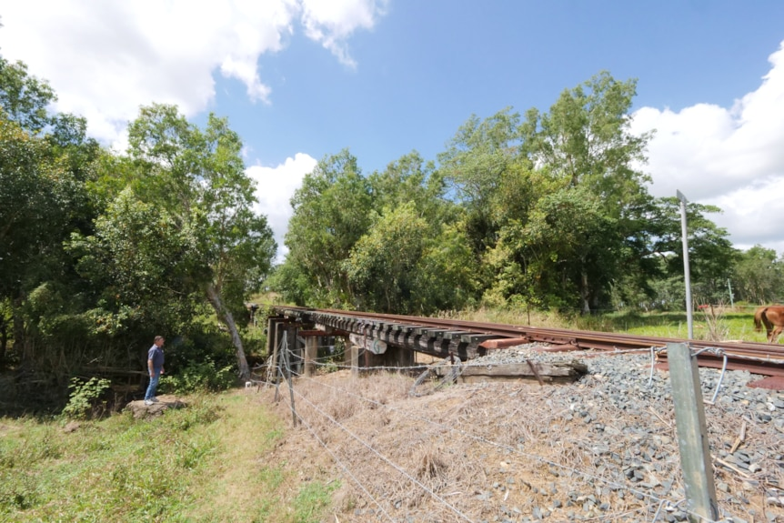 a railway track running over a small creek