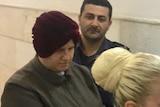Malka Leifer is walked into Jerusalem's District Court.
