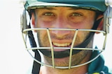 Phil Hughes looks on wearing helmet, August 2 2014