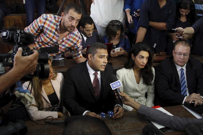 Al Jazeera television journalists talk to the media