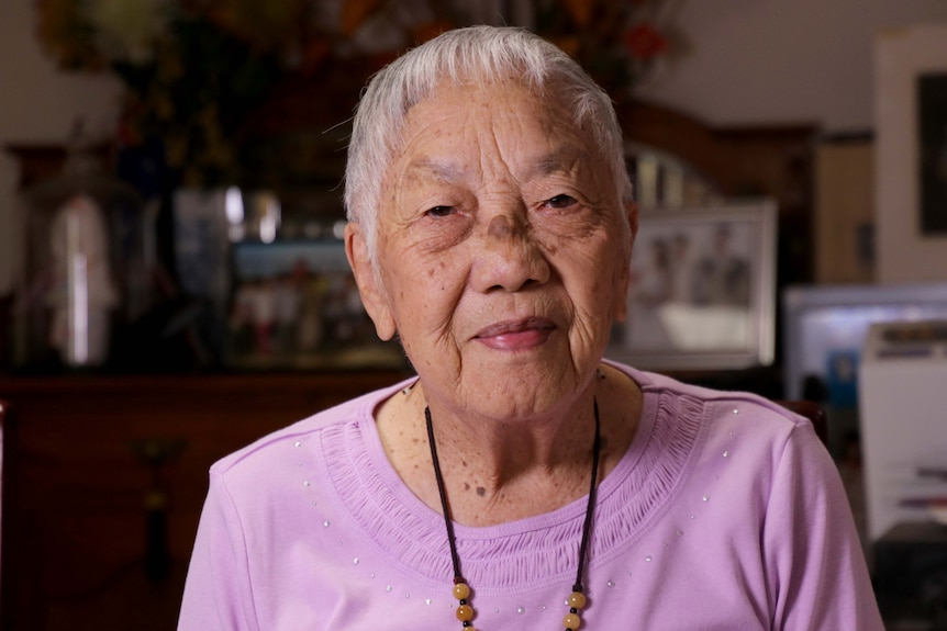 Headshot of an elderly Chinese woman.