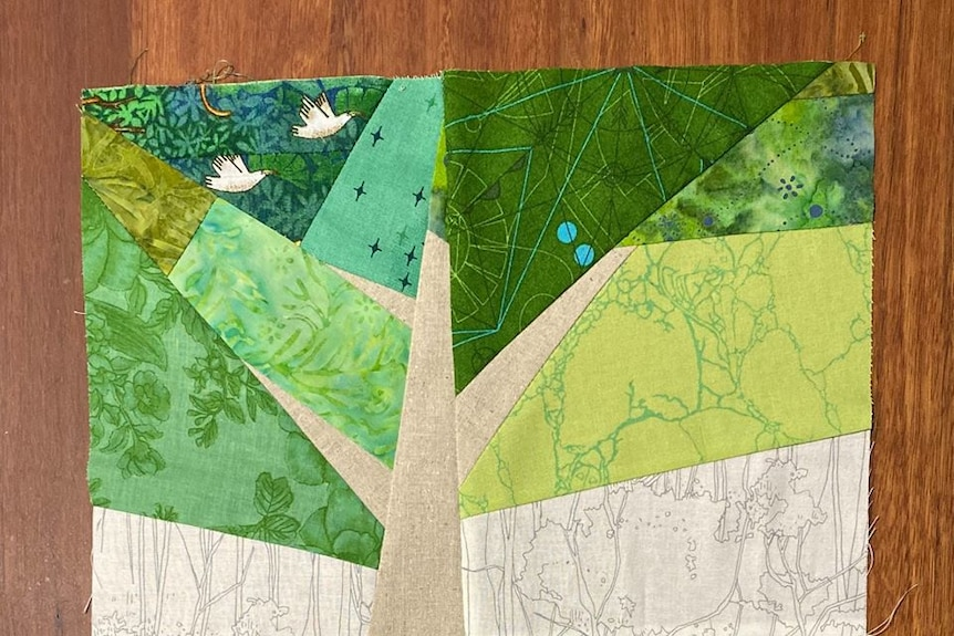 A 30cm square with a tree design featuring triangular shapes of different shades of green.