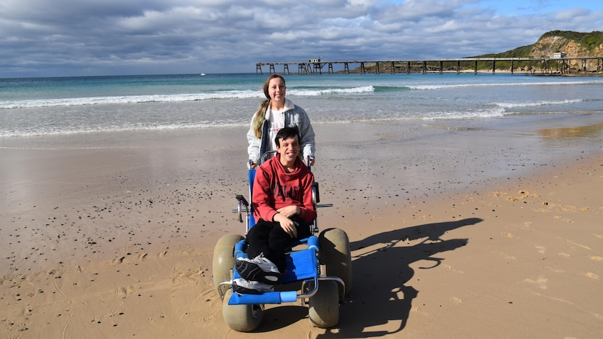 Julie's children on a beach in a story about affordable travel ideas that aren't camping.