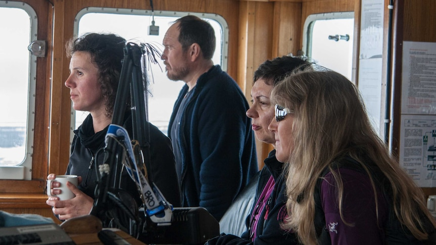 Amelie Meyer and crew in the cockpit of a ship.