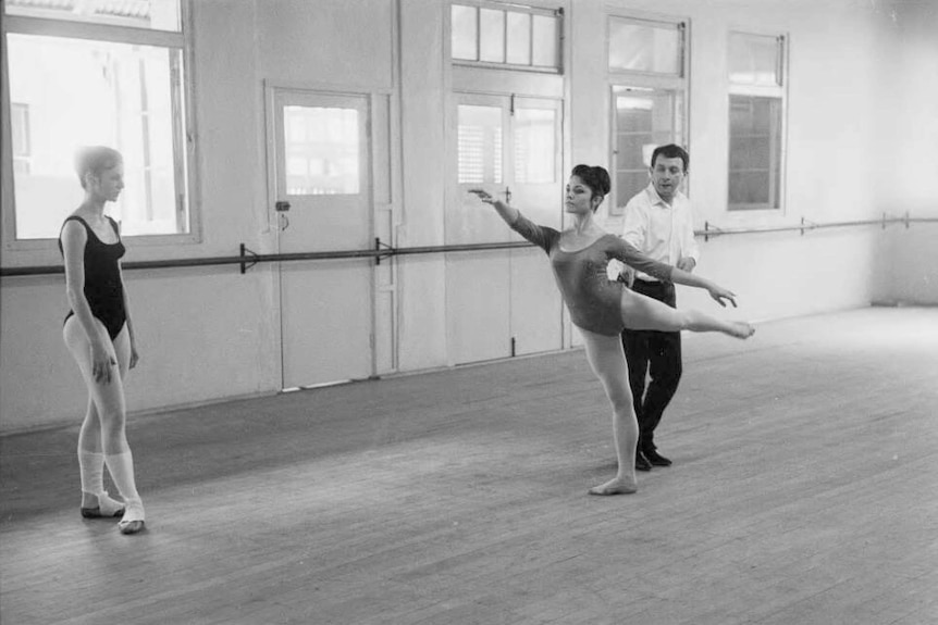 A black and white photo of Charles Lisner coaching a dancer.