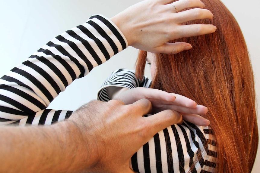 A man grabs a woman during an argument.