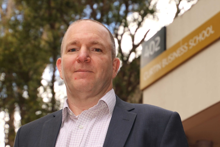 An image of Steven Rowley with a Curtin University Business School in the background.