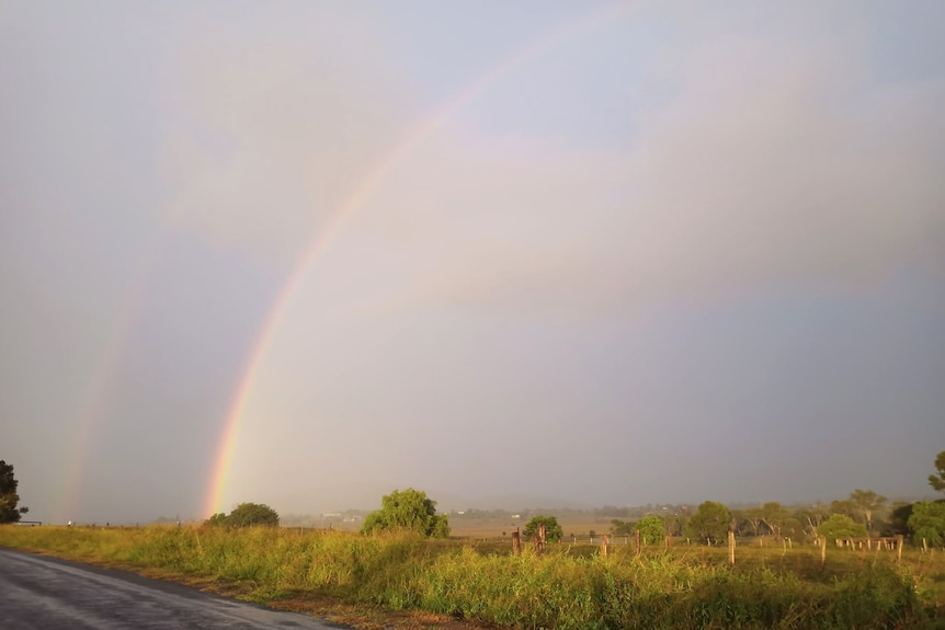 A rainbow stretching over countryside