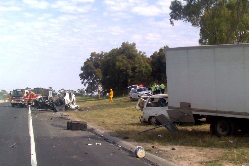 Paramedic Dave Llewelyn says the trucks have been 'sprayed across the freeway'.