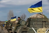A convoy of Ukrainian armed forces prepare to pull back from Debaltseve in eastern Ukraine