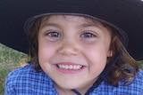 Sophie Mergler smiles for the camera in her school uniform