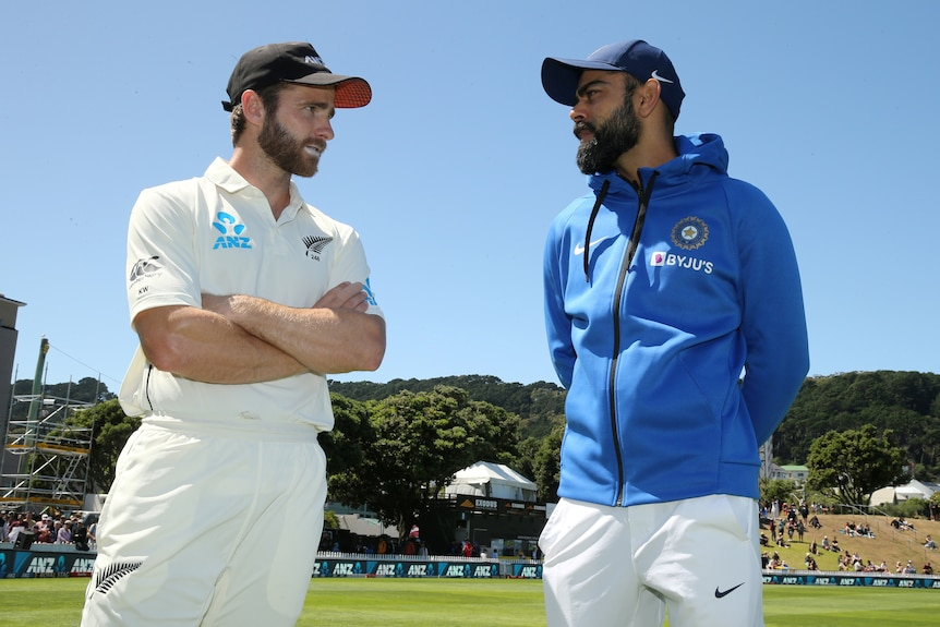 Two Test cricket captains from New Zealand and India talk after a match.