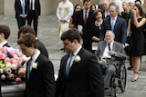 Former president George HW Bush and George W Bush follow Barbara Bush's coffin after her funeral service.