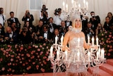 Katy Perry dressed as a chandelier at the Met Gala, in a story about why the Met Ball is ridiculous but important.