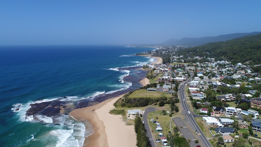 An aerial view of the beach and property, looking south from Coledale beach down the Illawarra coastline.