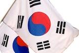 South Korean flags flying in Seoul.