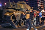 Dozens of people surround a military vehicle during an attempted coup in Ankara, Turkey