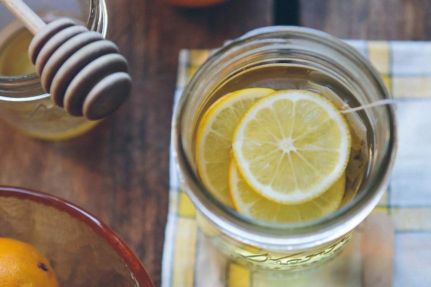 Hot honey and lemon drink in a jar