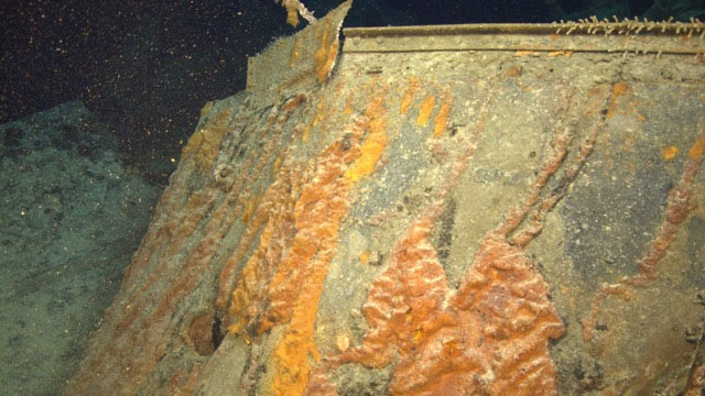 Close-up of previously unseen 15cm shell hole through bridge of HMAS Sydney