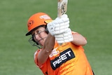Perth Scorchers batter Sophie Devine completes her swing during the WBBL game against the Brisbane Heat.