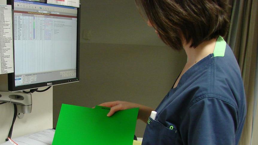 nurse with medical records folder