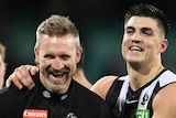 The Collingwood AFL coach and one of his player have a laugh at the SCG.