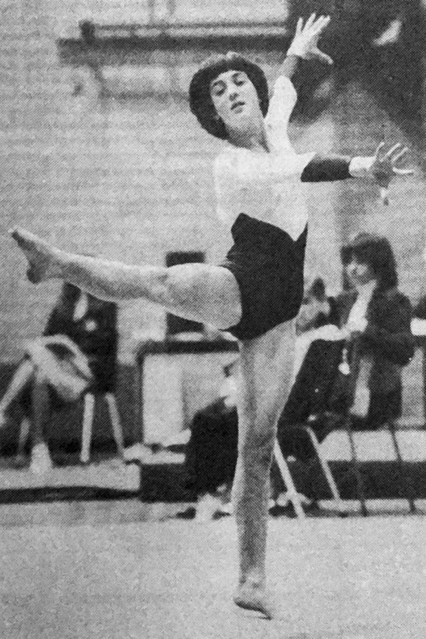 Black and white image of young teenager doing gymnastics